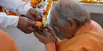 Taking Prasad in Temple