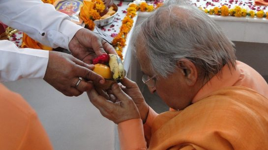 Taking Prasad in Temple